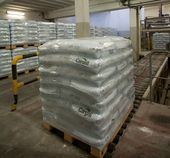 Palletized valve bags filled with THE ADAMS® FFS rotating filling machine